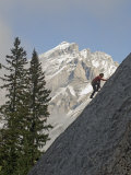 Rock Climber Ascends a Crag Below Cascade Mountain in Canada's Banff National Park Photographic Print by Gordon Wiltsie