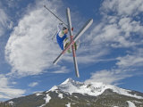 Skiing Aerial Maneuvers Off a Jump in a Terrain Park Photographic Print by Gordon Wiltsie