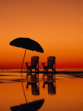 Picturesque Scene with Two Chairs and an Umbrella on the Beach Photographic Print by Michael Melford