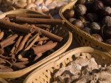 Cinnamon, Ginger, and Nutmeg on Display at the Spice Market Photographie par Abraham Nowitz