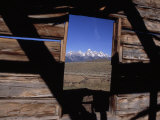 View of the Teton Mountains from an Old Homesteader's Cabin Photographic Print by Ed George