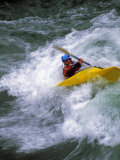 Kayaker Plays in Waves on the Kananaskis River, Near Calgary Photographic Print by Gordon Wiltsie