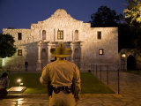 Rear View of a Texas Ranger Standing in Front of the Alamo at Twilight Photographic Print by Richard Nowitz