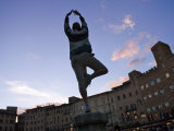 Siena, Italy, Piazza Del Campo-A Young Tourist Playfully Practices Yoga Photographic Print by  Keenpress