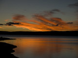 Ducks Swimming at Sunset in Yellowstone Lake Photographic Print by National Geographic Photographer