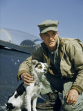 Marine Corps Corporal Poses with Squadron's Mascot on Panther Wing Fotografisk trykk av Joseph Baylor Roberts
