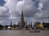 Wat Arun Temple Towers over the Muddy Waters of the Chao Phraya Photographic Print by W. Robert Moore