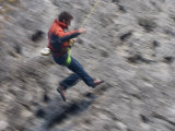 Rock Climber Swings across a Crag in Canada&#39;s Banff National Park Photographic Print by Gordon Wiltsie
