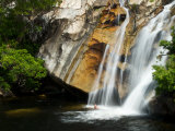 Male Swimming at the Base of Waterfall in Atherton Tablelands Photographic Print by Brooke Whatnall