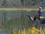 Boy Sits on a Log Trout Fishing in Grass Lake Photographic Print by Gordon Wiltsie