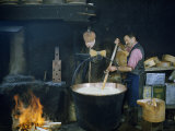 Man Making Cheese Combs Curd in Caldron Just Removed from Fire Photographic Print by Volkmar K. Wentzel