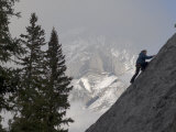 Rock Climber Scales a Face Below Cascade Mountain in Canada&#39;s Banff National Park Photographic Print by Gordon Wiltsie