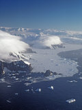 Icebergs and Pack Ice in the Southern Ocean Below Mountains Photographic Print by Gordon Wiltsie