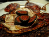 Close Up of Blood Pudding Tapas at a Restaurant Photographic Print by Raul Touzon