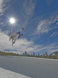 Skiing Aerial Maneuvers and Flips in Half Pipe in a Terrain Park Photographic Print by Gordon Wiltsie