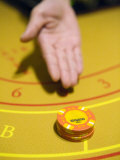 Stack of Chips from the Banker to Player in a Game of Baccarat Photographic Print by  xPacifica