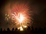 Group of People Watch Fireworks Light Up the Sky at a Fiesta Photographic Print by Ralph Lee Hopkins