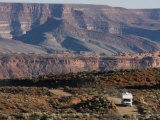Vehicle Driving in Valley of the Gods Near Mexican Hat, Utah Photographic Print by Scott Warren