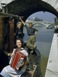 Playing and Listening to an Accordion, a Barge Family Relaxes Photographic Print by Justin Locke