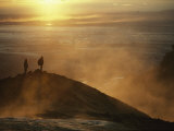 Two Silhouetted Men at Twilight Amid Geothermal Steam on Mountain Top Fotografisk tryk af Paul Chesley