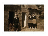 Girls Stand Outside Thatched Cottages in Brittany Lámina fotográfica por Courtellemont, Gervais