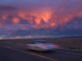 Vintage Car Drives Along a Vacant Road in Taos, New Mexico Photographic Print by Ralph Lee Hopkins
