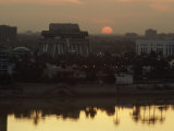 Baghdad and the Tigris River at Sunset Photographic Print by Lynn Abercrombie