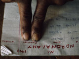 Traditional Healer Signs a Pay Ledger with His Fingerprints Photographic Print by Lynn Johnson