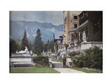 Man Stands Guard of Castle Peles, with Mountains in the Background Photographic Print by Wilhelm Tobien