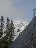 Rock Climber Rappels Down a Crag Below Cascade Mountain Photographic Print by Gordon Wiltsie
