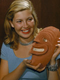 Smiling Woman Holds a Smiling Mask Carved by a Native American Photographic Print by Bates Littlehales