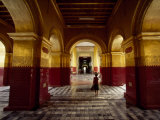 Girl Walking Through Building of Typical Burmese Architecture Fotografisk tryk af Paul Chesley