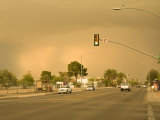 Large Sandstorm Approaches Town, Coloring the Sky over Tucson Brown Photographic Print by Mike Theiss