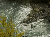 Kayaker Passes Rocky Point on Kananaskis River Provincial Park Photographic Print by Gordon Wiltsie