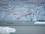 Boat Rows Along Mendenhall Glacier in Juneau, Alaska Photographic Print by Michael Melford