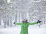 Woman Enjoying a Snowstorm Photographic Print by John Burcham