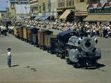 People Watch a Miniature Train Parade on Main Street Photographic Print by Jack Fletcher