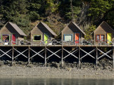 Tiny Cabins on a Pier at Halibut Cove in Alaska Photographic Print by Michael Melford