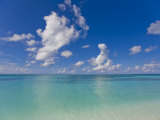 Perfect Day with Blue Skies, Clear Water, and Puffy White Clouds Photographic Print by Mike Theiss