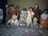 Women Demonstrate How to Make a Patchwork Quilt at a Festival Photographic Print by Maynard Owen Williams