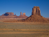 Desert Landscape with Rock Formations in Arizona's Monument Valley Photographic Print by Mike Theiss
