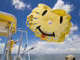 Parasail Operator Prepares Parachute for the Next Set of Tourists Photographic Print by Mike Theiss