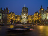 Cars Streak by the Chhatrapati Shivaji Terminus or Victoria Terminus Photographic Print by Abraham Nowitz