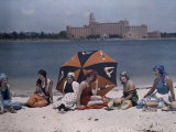 Six Women Sit on a St. Petersburg Beach with the Water Behind Them Photographic Print by Clifton R. Adams