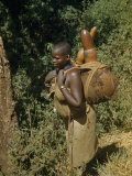 Woman Carries Gourds Filled with Water Photographic Print by W. Robert Moore