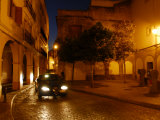 Street Scene with a Car at Night Photographic Print by Raul Touzon