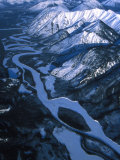 Aerial over a Frozen River and Snow Capped Mountains Photographic Print by Nick Norman