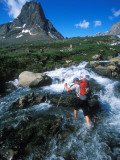 Man Crossing a River in Greenland Photographic Print by John Burcham
