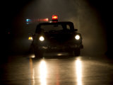 Antique Police Car on Night Patrol Photographic Print by Pete Ryan