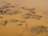 Aerial View of a Road Slicing Through a Desert with Sand Dunes Photographic Print by Michael Polzia